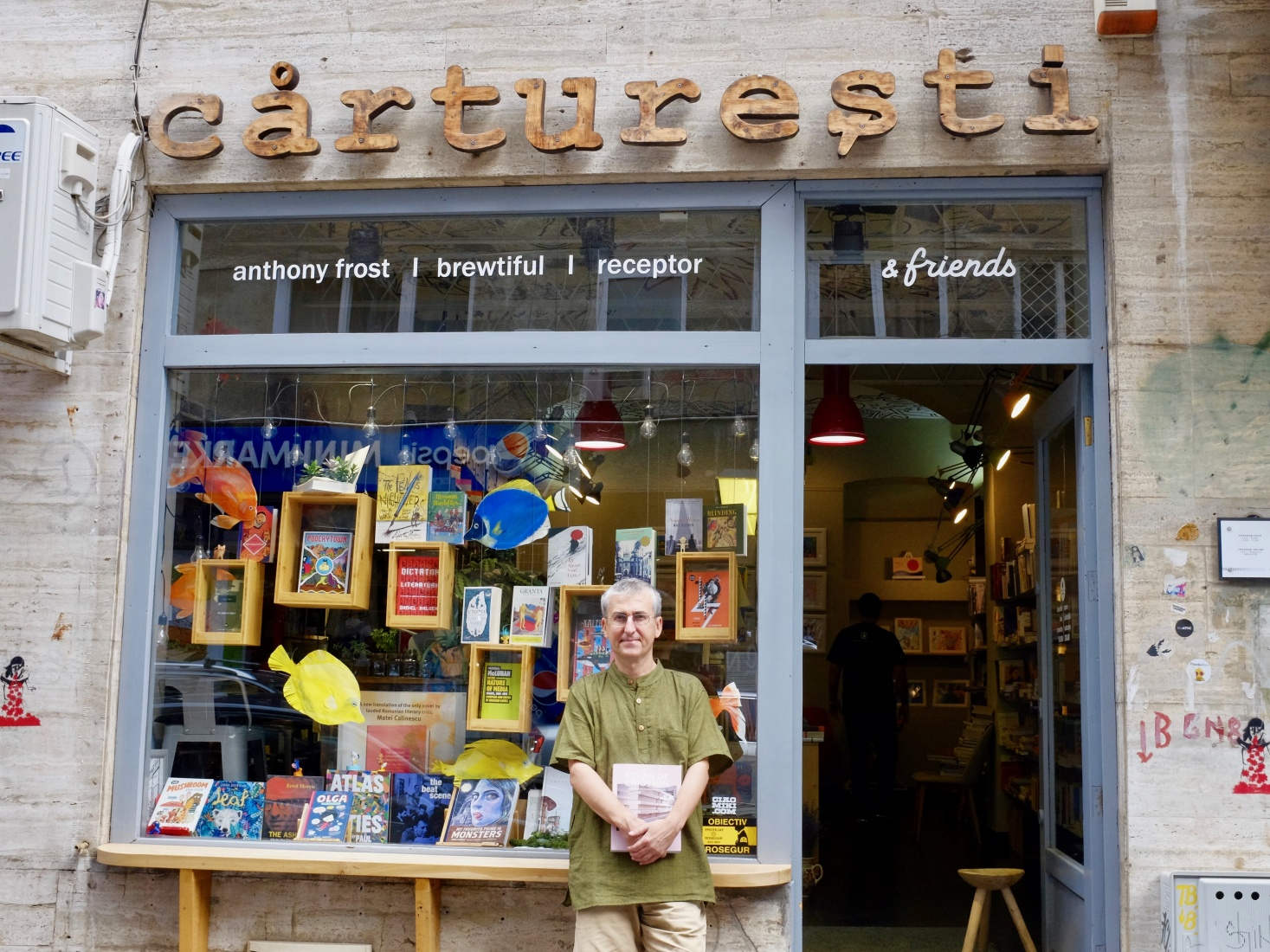'Cărturești & Friends' owner-operator Vlad Niculescu in front of his reinvigorated storefront in Bucharest, Romania.