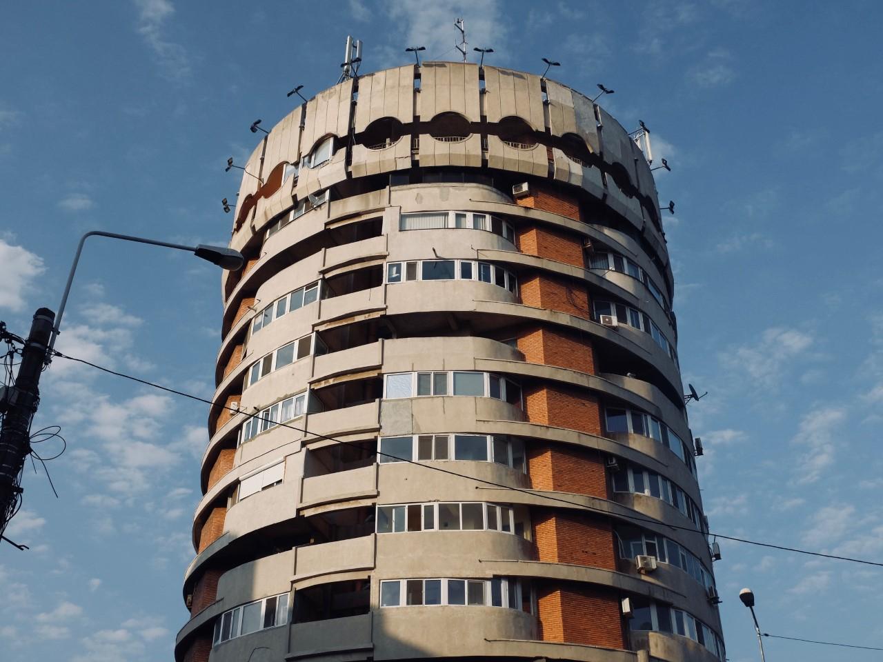An apartment complex displaying Communist era architecture near the beach in Constanța, Romania.