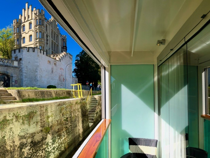 Balcony of a cabin on the National Geographic ship, with a view of a 19th century neo-Gothic castle in  Regensburg, Germany.