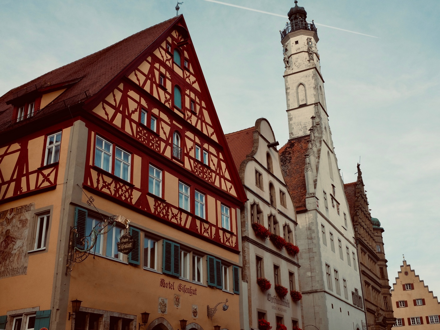 Rothenburg ob der Tauber, Germany, with trademark half-timbered houses and the tall Rathaus tower in the background.